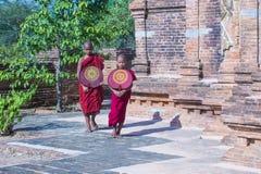 Novice monks in bagan Myanmar. BAGAN , MYANMAR - SEP 05 2017: Novice monks in bagan Myanmar on September 05 2017 , The ruins of Bagan has 2,200 temples and stock images