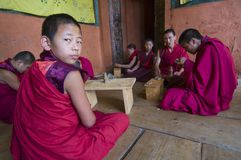 Novice monks practice sculpture Torma , Bhutan royalty free stock photos