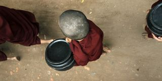 Novice monks recept  alms. In the historical park of Bagan,Myanmar stock images