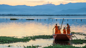 Novice monks. Row a boat in the lake,Phayao,Thailand Royalty Free Stock Image