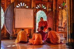Novice monks studying at the monastery stock photography