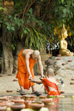 Novice prepare floating candles in to the Buddha. Royalty Free Stock Image