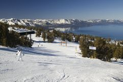 Novice on a ski slope. A young inexperienced female skier going down the slope on a lake tahoe ski resort Stock Photo