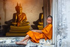 Novice sleeping on the terrace after hard study discipline outside of The Buddha Status. Temple in Thailand Royalty Free Stock Photo