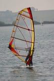 Novice windsurfer. On calm water Royalty Free Stock Photo