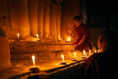 Novices Praying Stock Images