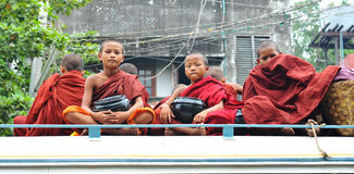Novices sitting on the local bus in Shan, Myanmar Stock Images