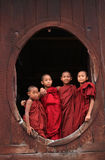 Novices standing at the wooden monastery in Shan, Myanmar Stock Photography