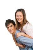 Novio lindo que lleva a cuestas a su novia. Fotos de archivo libres de regalías