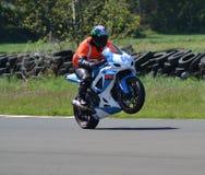 Novise bike racer. GSXR Suzuki wheelie motorbike racing stock images