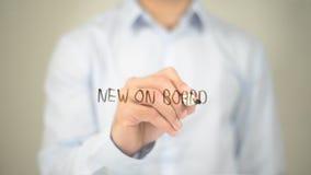 Novo a bordo, escrita do homem na tela transparente Imagem de Stock Royalty Free