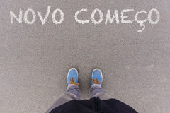 Novo comeco, Portuguese text for New Beginning text on asphalt  Stock Photo