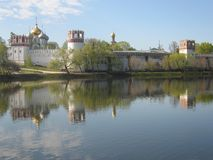 Novodevichiy monastery Moscow Russia. Novodevichiy monastery in Moscow, Russia, on bank of lake, reflection of building in water Stock Photos