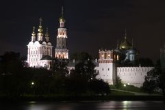 Novodevichy convent in Moscow at night. The convent was founded in 1524 to commemorate joining of Smolensk city to Russia. Belfry and church have been bult in Stock Image