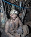 Novogrodovka, Ucrânia - 18 de janeiro de 2013: Mineiro no local de trabalho Imagens de Stock Royalty Free