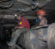 Novogrodovka, Ukraine - January, 18, 2013: The miners in the min Stock Photography