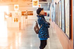 Novokuzneck, Russia - 09.04.2018: girl in picture Museum. Novokuzneck, Russia - 09.04.2018: Young woman looking at modern painting in art gallery Royalty Free Stock Photos