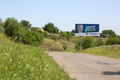A poster depicting the former President of Ukraine Poroshenko in the village of. Novonikolaevka, Ukraine - June 06, 2019: A poster depicting the former President stock photography