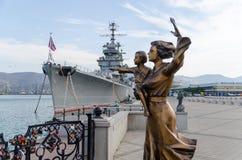 Novorossiysk. Cruiser Mikhail Kutuzov and monument to the Sailor Stock Photography