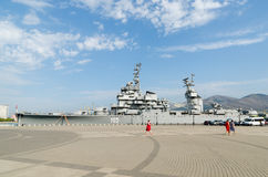 Novorossiysk. The cruiser Mikhail Kutuzov and Shore Promenade be Royalty Free Stock Images