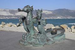 Artistic monument, seahorses, harnessed in a carriage. Copper is a material of statues. Embankment of the Admiral Serebryakov. Novorossiysk, Russia - September Royalty Free Stock Photos