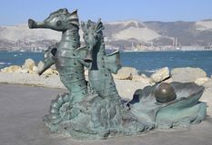 Artistic monument, seahorses, harnessed in a carriage. Copper is a material of statues. Embankment of the Admiral Serebryakov. Novorossiysk, Russia - September Royalty Free Stock Photo