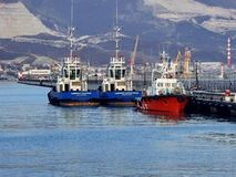 NOVOROSSIYSK, RUSSIA.Tugboats at the berth of the West breakwater Novorossiysk. stock photography
