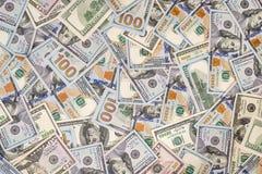 100 novos e notas de dólar velhas Foto de Stock