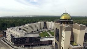 Novosibirsk, Akademgorodok, 2015: Modern university building aerial. Novosibirsk, Akademgorodok, 2015: Aerial view from helicopter of The new building of the stock video