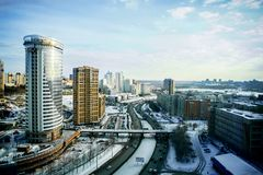 Novosibirsk cityscapes and roads, top view in winter. Novosibirsk cityscapes, high rise office and residential buildings and skyscrapers in city, road for cars royalty free stock images