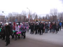 Novosibirsk day holiday Joyful crowd of people walking along the road watching the event stock photo