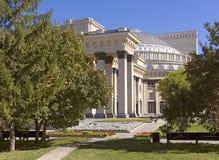Novosibirsk Opera and ballet theatre through the trees royalty free stock photos
