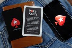 NOVOSIBIRSK ROSJA, GRUDZIEŃ, - 13, 2016: Logo Pokerstars w iphone Apple Obrazy Stock