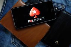 NOVOSIBIRSK ROSJA, GRUDZIEŃ, - 13, 2016: Logo Pokerstars w iphone Apple Obrazy Royalty Free