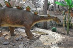 NOVOSIBIRSK, RUSSIA - APR 16: Realistic model of dinosaur at Dinopark in Zoo on Apr 16, 2016 Novosibirsk. NOVOSIBIRSK, RUSSIA - APR 16: Realistic model of stock photos