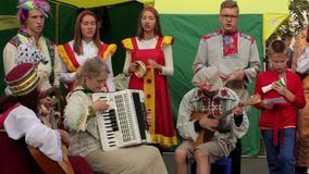 NOVOSIBIRSK, RUSSIA - April 30, 2017: festive performance of the Russian folklore ensemble stock video