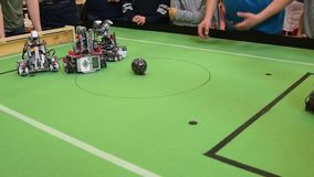 Shooting a goal during robots football game stock footage
