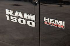 Black Dodge Ram with an engine of 5.7 liters front fender view with emblem 1500 Hemi on the car parking with snow background stock images