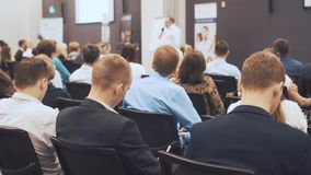 NOVOSIBIRSK RUSSIA - 20.06.2017: business people seminar meeting office training concept. Men and women listen to a. Seminar in the conference room. Problems of stock video