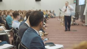 NOVOSIBIRSK RUSSIA - 20.06.2017: business people seminar meeting office training concept. Men and women listen to a. Seminar in the conference room. Problems of stock footage