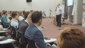 NOVOSIBIRSK RUSSIA - 20.06.2017: Business People Seminar Meeting Office Training Concept. Men and women listen to a. Seminar in the conference room. Problems of stock video footage