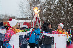 Novosibirsk, Russia - December 7, Adults and children awaiting t. Passing the torch relay, in Novosibirsk, Russia Stock Images