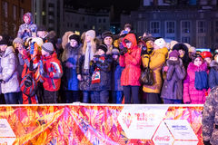 Novosibirsk, Russia - December 7, Adults and children awaiting t. Passing the torch relay, in Novosibirsk, Russia Stock Photo