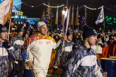 Novosibirsk, Russia - December 7. Karelin, Alexander with the Ol. Passing the torch relay, in Novosibirsk, Russia Royalty Free Stock Image
