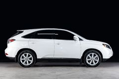 Novosibirsk, Russia - February 08, 2019: Lexus RX 350. Side view. Photography of a modern car on a parking in Novosibirsk against a black wall stock photos