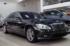 Front quarter view of the 2006 Mercedes Benz S-Class Limousine sedan prepared for sale and exhibited in the showroom with a royalty free stock photography