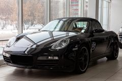 Front view of the 2006 sports porsche boxster s sedan prepared for sale and exhibited in the showroom with a polished shiny black stock images