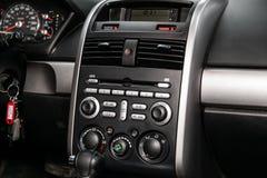 Novosibirsk, Russia June 28, 2019: Mitsubishi Galant. Novosibirsk, Russia – June 28, 2019: Mitsubishi Galant,close-up of the dashboard, adjustment of the stock photo