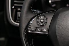 Novosibirsk, Russia June 30, 2019: Mitsubishi Outlander. Novosibirsk, Russia – June 30, 2019:  Mitsubishi Outlander, Car controller on steerling wheel stock image