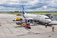 Tolmachevo Airport, ground handling services of airplane Boeing 737-800 named after N. Leskov, Aeroflot Airlines stock photos